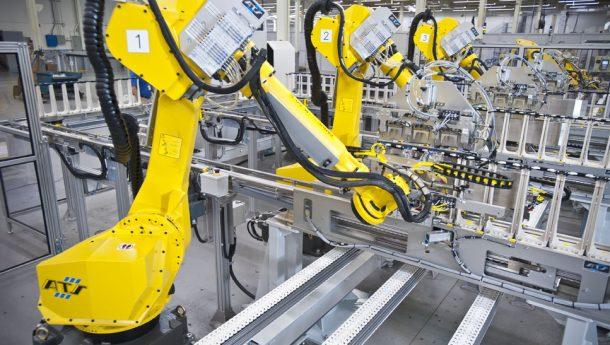 ABB robots feeding IV bags onto conveyor,